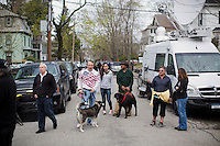 Media and crowds gather on Franklin Street in Watertown, Mass., near the scene of the capture of Boston Marathon Bombing suspect #2 Dzhokhar Tsarnaev, on April 20, 2013.  Tsarnaev was captured the day before just a block away in a residential area of Watertown after a day-long search that shut down the metropolitan Boston area.