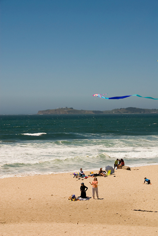 People playing on the beach at Half Moon Bay Beaches, .San Mateo Coast of California, south of San Francisco.  Photo copyright Lee Foster, 510-549-2202, lee@fostertravel.com, www.fostertravel.com.  Photo 441-31147