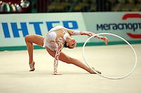 """Anna Bessonova of Ukraine begins routine with hoop at 2008 World Cup Kiev, """"Deriugina Cup"""" in Kiev, Ukraine on March 22, 2008."""