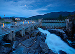 Idaho, North, Post Falls. The Post Falls Dam at twilight under a full moon.
