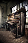 Broken down piano found in derelict school house in Arizona, USA
