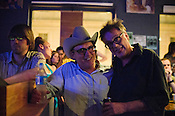 Kurt Wagner of Kort with local Raleigh bartender, Gary Poole, watching Little Scream at King's Barcade during the Independent Weekly's Hopscotch Music Festival, Saturday, September 10, 2011.