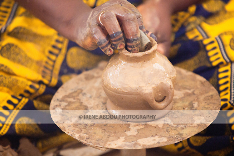 In the town of Djibo in northern Burkina Faso, a potter creates pots, sculptures, and decorative items from clay.