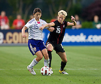 Megan Rapinoe (15) of the USWNT fights for the ball with Aya Sameshima (15) of Japan during the game at WakeMed Soccer Park in Cary, NC.   The USWNT defeated Japan, 2-0.