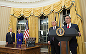 Treasury Secretary Seven Mnuchin delivers remarks alongside President Donald Trump (2nd-R), Vice President Mike Pence and his fiancee Louise Linton, after being sworn-in as Secretary during a ceremony at the White House in Washington, D.C. on February 13, 2017. Mnuchin was confirmed by the Senate 54-47 earlier today. <br /> Credit: Kevin Dietsch / Pool via CNP