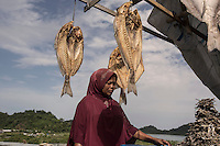 """Indonesia – Sumatra – Aceh – Layuen - 45-year-old fish seller Nurul Hayati complains that """"Before the tsunami I had a big business. I was selling 100 kg of fish per day, now fishermen are scared to go to the open sea and there is no more fish to sell"""". """"We are going through hard times, but at least we have a house"""" she says, referring to the reconstruction of the village carried out by World Vision. """"It's still better than sleeping under a tree"""""""