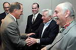 WATERBURY, CT - 27 April 2004 - 042704TH04 -  Daniel H. Leever, chairman and CEO of MacDermid Inc.,  shakes hands with Walt Dyber of West Hartford, a retired 30-year employee of MacDermid before the annual shareholders' meeting held The Harold Leever Building at MacDermid headquarters on Freight Street in Waterbury.   Also in the photo from left to right are Sam Ponticello, a 40-year retired employee out of Avon, Stephen Largan, president of MacDermid Inc., and Al Jocis, a 15-year retired employee out of Stafford Springs.  TODD HOUGAS PHOTO