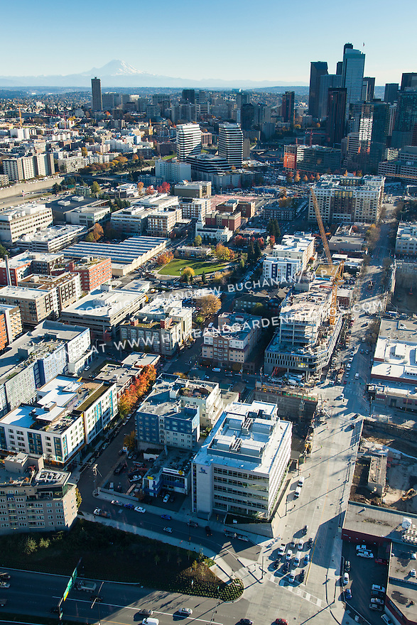 Aerial view of Seattle's South Lake Union neighborhood with BioMed Realty Research Center in the foreground and the downtown skyline and Mount Rainier in the background
