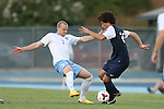 30 August 2013: North Carolina's Josh Rice (7) and Monmouth's Bryant Avalos (25). The University of North Carolina Tar Heels hosted the Monmouth University Hawks at Fetzer Field in Chapel Hill, NC in a 2013 NCAA Division I Men's Soccer match. UNC won the game 1-0 in two overtimes.