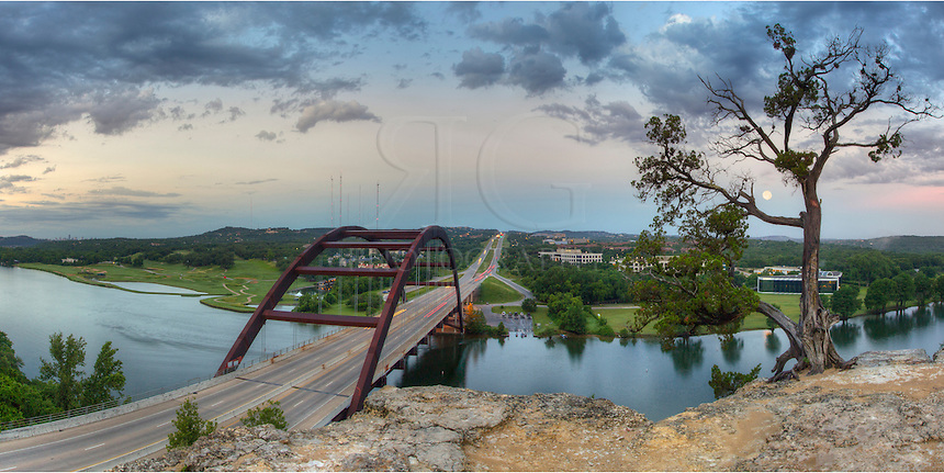 Showing a 180 degree view, this Austin panorama of the 360 Bridge lookout shows the Texas landscape from this iconic location. To the south is the Austin skyline. To the northwest the moon sets into the Texas Hill Country.