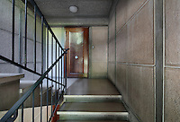 Stairwell lined in concrete, leading to the Historic Show Flat, on the first floor of an ISAI or Immeubles Sans Affectation Individuelle apartment block, designed from 1946 by Auguste Perret, 1874-1954, who led the reconstruction of Le Havre in the 1950s, after the town was completely destroyed in WWII, Le Havre, Normandy, France. The apartment, of early 1950s design, used all modern conveniences, including internal kitchen and bathroom, contemporary mass produced oak furniture, natural light flowing from front and back, children's study bedroom, central heating and domestic appliances such as vacuum cleaners and refrigerators. Rene Gabriel and Marcel Gascoin designed the furniture in Scandinavian style, which came to typify reconstruction design. The centre of Le Havre is listed as a UNESCO World Heritage Site. Picture by Manuel Cohen
