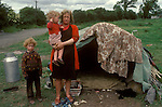 Gypsy family mother children with bender sleeping accommodation West Coast Southern Ireland Eire