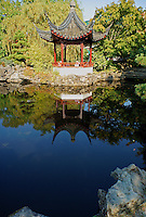 Chinese pagoda reflected in a pond, Sun Yat-sen Park, Chinatown, Vancouver, BC, Canada