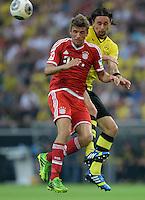 FUSSBALL   1. BUNDESLIGA   SAISON 2013/2014   SUPERCUP Borussia Dortmund - FC Bayern Muenchen           27.07.2013 Thomas Mueller (li, FC Bayern Muenchen) gegen Neven Subotic (re, Borussia Dortmund)