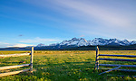 Idaho, Southcentral, Stanley. The Sawtooth Range and fence in late Spring.