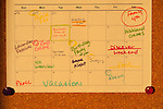 Home bulletin board with notes, schedules, reminders, and important dates to remember