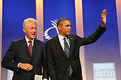 United States President Barack Obama, right, waves to the audience following a conversation about health care with former U.S. President Bill Clinton, left, at the Clinton Global Initiative in New York, New York on Tuesday, September 24, 2013.<br /> Credit: Allan Tannenbaum / Pool via CNP