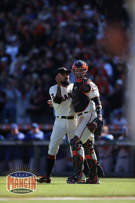 SAN FRANCISCO, CA - OCTOBER 2:  Sergio Romo #54 of the San Francisco Giants celebrates with Buster Posey #28 after the game against the Los Angeles Dodgers at AT&T Park on Sunday, October 2, 2016 in San Francisco, California. The Giants beat the Dodgers 7-1 to clinch a postseason berth as a Wild Card representative in the National League. Photo by Brad Mangin