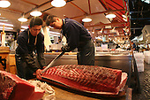 Mar 4, 2006; Tokyo, JPN; Tsukiji.Raw tuna is cut into different size filets before being sold at the Tsukiji Fish Market...Photo credit: Darrell Miho