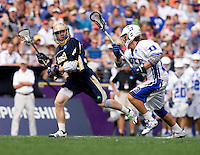 Sam Solie (23) of Duke defends Grant Krebs (12) of Notre Dame during the NCAA Men's Lacrosse Championship held at M&T Stadium in Baltimore, MD.  Duke defeated Notre Dame, 6-5, to win the title in overtime.