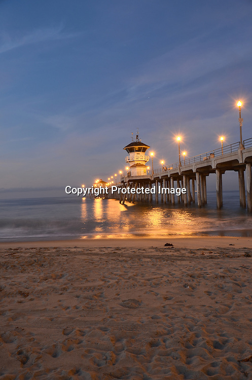 Stock Photos of Huntington Beach Pier located in Orange County California. The photo shows the Pacific Ocean and beach sands