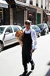 Man carrying bread in Paris, Rue Saint-Louis en L'ile, Ile Saint-Louis, Paris, France, Europe