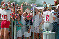 ROCKLIN, CA - Quarterback Joe Montana, left, and quarterback Steve Young of the San Francisco 49ers sign autographs for the fans after practice at training camp at Sierra College in Rocklin, California in 1988. Photo by Brad Mangin