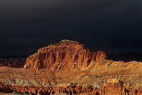 731350046 threatening storm clouds backdrop the sandstone formations of the waterpocket foldl in capitol reef national park in utah