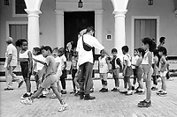 Cuban elementary students line up in martial form after a field trip through the city.