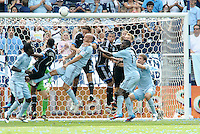A corner kick by Kansas City creates some action in the San Jose goal mouth... Sporting Kansas City defeated San Jose Earthquakes 2-1 at LIVESTRONG Sporting Park, Kansas City, Kansas.