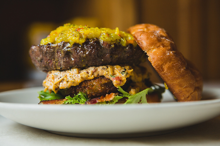 Raleigh, North Carolina - Friday January 8, 2016 - The Shoo Mercy Burger is a Creekstone Farms pasture-raised Black Angus USDA patty, served with lettuce, fried green tomato, bacon, warm pimento cheese and green tomato chow chow at Tupelo Honey in Raleigh, North Carolina.