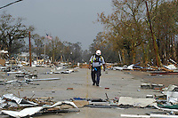 A lone search and resucer is seen in Waveland Ms. following Hurricane Katrina, Aug. 31,2005.