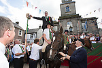 Langholm Common Riding 2016. First Fair Crying, Proclamation of Langholm Fair and Common Riding done by standing on a horses backs. Barley Bannock and salted herring