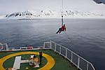 Videographer Jari Stahl on the Esperanza Crane, in Woodfjorden, Svalbard, Arctic Under Pressure expedition 2010