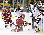 Colin Moore (Harvard - 12), Braden Pimm (Northeastern - 14), Daniel Moriarty (Harvard - 11), Garrett Vermeersch (Northeastern - 9) - The Northeastern University Huskies defeated the Harvard University Crimson 4-0 in their Beanpot opener on Monday, February 7, 2011, at TD Garden in Boston, Massachusetts.