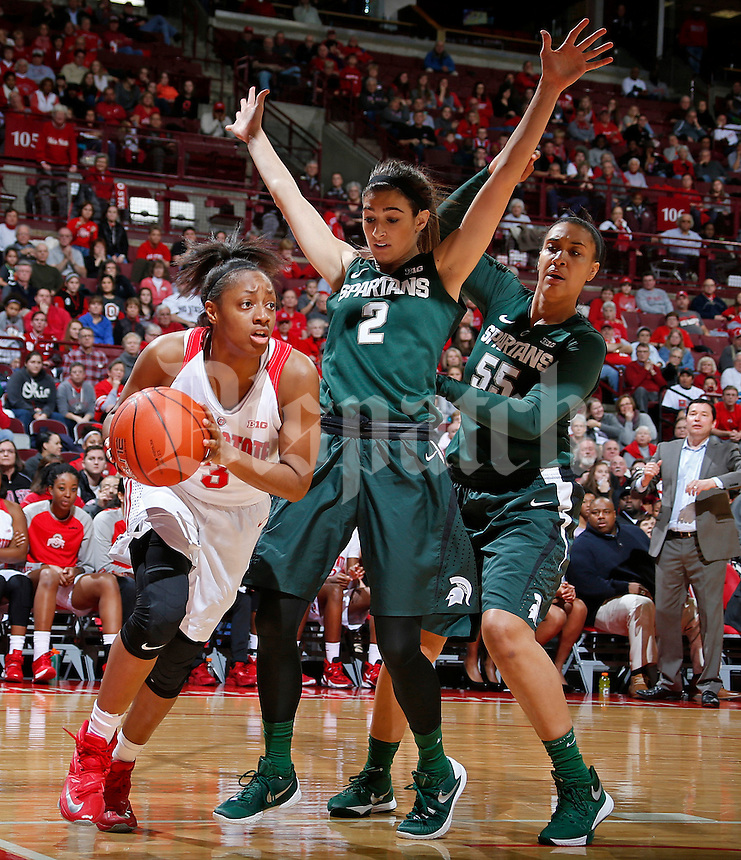 Kelsey Mitchell (3) of the Ohio State Buckeyes is guarded by Cara Miller (2) and Kennedy Johnson (55) of the Michigan State Spartans during Thursday's NCAA basketball game in Value City Arena at the Jerome Schottenstein Center in Columbus on December 31, 2015. Ohio State won the game 85-80. (Barbara J. Perenic/The Columbus Dispatch)