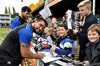 Leroy Houston of Bath Rugby mingles and signs autographs with supporters at the end of the session. Bath Rugby Captain's Run on October 30, 2015 at the Recreation Ground in Bath, England. Photo by: Patrick Khachfe / Onside Images