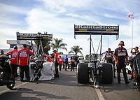 Feb 14, 2016; Pomona, CA, USA; Crew members with NHRA top fuel driver Doug Kalitta (left) and J.R. Todd during the Winternationals at Auto Club Raceway at Pomona. Mandatory Credit: Mark J. Rebilas-USA TODAY Sports