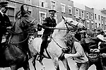 Lewisham, London.1977<br /> Police protect members of the National Front, during the so-called Battle of Lewisham, which took place on 13 August. 500 members of the National Front marched from New Cross to Lewisham, various counter-demonstrations by approximately 4,000 people led to violent clashes between the two groups and between the anti-NF demonstrators and police. 5,000 police officers were present and 56 officers were injured in the riots, 11 of whom were hospitalised. 214 people were arrested for obstructing the police, threatening behaviour, assault, possession of an offensive weapon and throwing missiles. Later disturbances in Lewisham town centre saw the first use of police riot shields on the UK mainland.
