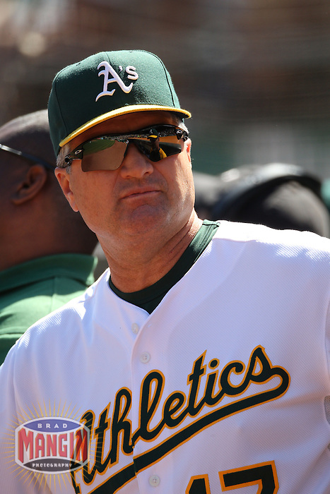 OAKLAND, CA - SEPTEMBER 12:  Manager Bob Geren #17 of the Oakland Athletics watches from the dugout against the Boston Red Sox during the game at the Oakland-Alameda County Coliseum on September 12, 2010 in Oakland, California. Photo by Brad Mangin