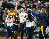 Michigan Wolverines infielder Abby Ramirez (1), catcher Lauren Sweet (25) and utility player Kelsey Susalla (7) in between innings during the season opener against the Florida Gators on February 8, 2014 at the USF Softball Stadium in Tampa, Florida.  Florida defeated Michigan 9-4 in extra innings.  (Copyright Mike Janes Photography)