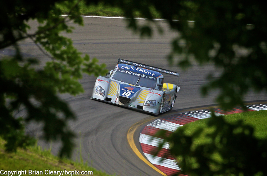 The #10 Chevrolet Dallara of Ricky Taylor and Max Agelelli races past some trees en route to victory in the Sahlen's Six Houra at Watkins Glen, June 4, 2011.  (Photo by Brian Cleary/www.bcpix.com)