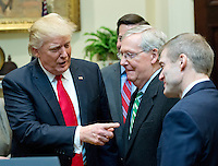 United States President Donald J. Trump, left, speaks with US Senate Majority Leader Mitch McConnell (Republican of Kentucky), center and US Representative Jim Jordan (Republican of Ohio), right prior to signing H.J. Res. 38, disapproving the rule submitted by the US Department of the Interior known as the Stream Protection Rule in the Roosevelt Room of the White House in Washington, DC on Thursday, February 16, 2017.  The Department of Interior's Stream Protection Rule, which was signed during the final month of the Obama administration, &quot;addresses the impacts of surface coal mining operations on surface water, groundwater, and the productivity of mining operation sites,&quot; according to the Congress.gov summary of the resolution.<br /> Credit: Ron Sachs / Pool via CNP /MediaPunch