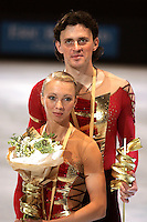 November 19, 2005; Paris, France; Figure skating stars TATIANA TOTMIANINA and MAXIM MARININ of Russia celebrate winning gold in pairs figure skating at Trophee Eric Bompard, ISU Paris Grand Prix competition.  Totmianina and Marinin are one of the favorites for medals in pairs at the Torino 2006 Olympics.<br />