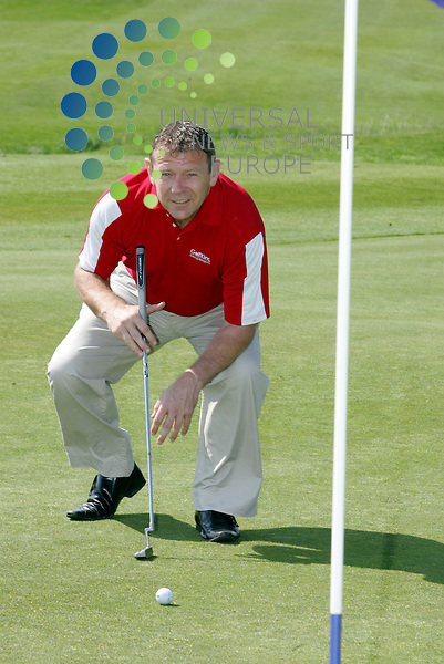 Andy lining up a put.Tommy Burns Masters golf fund raisin . tournament in aid of the Tommy Burns Skin Cancer Trust played over the Dundonald links.<br /> Picture: Universal News And Sport (Scotland) 25 May 2012.
