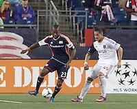 New England Revolution defender Jose Goncalves (23) works to clear ball as Real Salt Lake forward Devon Sandoval (49) pressures.