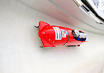 22 November 2009:  Hiroshi Suzuki, piloting the Japan 1 bobsled, leads his 4-man team at the FIBT World Cup competition, in Lake Placid, New York, USA. Mandatory Credit: Ed Wolfstein Photo
