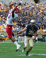 Youngstown State wide receiver Aaron Pitts makes a catch in front of Pitt defensive back Dom DeCicco (31). The Pittsburgh Panthers defeated the Youngstown State Penguins 38-3 at Heinz Field on September 5, 2009.
