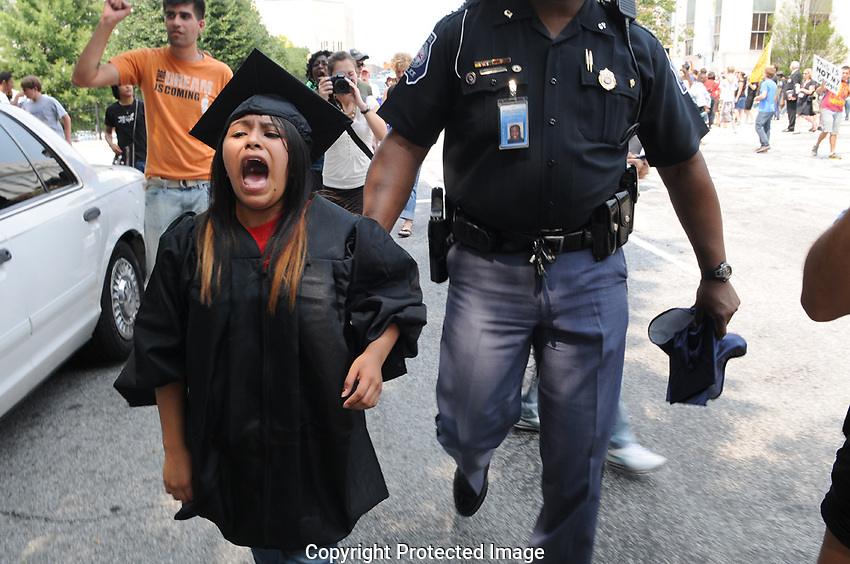 Capitol Police today arrested six undocumented youths who blocked traffic near the Gold Dome to protest Georgia's controversial immigration law.<br /> <br /> Protest organizers say the students arrested were Dulce Guerrero, 18; Jessica Vasquez, 18; Rolando Zenteno, 16; Nataly Ibarra, 16; Felipe Baeza, 24; and Leeidy Solis, 16. The organizers say all are Georgia residents and high school students, with the exception of Baeza, who lives in and recently graduated from college in New York.<br /> <br /> &quot;I am so happy to do this because we need to stand up for what we believe,&quot; Ibarra, a senior at Pebblebrook High School, said before being arrested. &quot;I am tired of having to live in the shadows.&quot;.<br /> <br /> Today's protest comes several months after more than 100 protesters  including seven undocumented students  urged Georgia State University not to comply with a law that prohibits undocumented immigrants from attending some of the state's most competitive public colleges. The seven youths were arrested after sitting in the middle of Courtland Street but were not deported.<br /> <br /> A federal judge yesterday temporarily blocked parts of Georgia's law that penalizes people who aid or transport undocumented immigrants or fail to verify whether employees are authorized to work in the United States. The state says it will appeal the decision.<br /> <br /> UPDATE 5:18 p.m.: A spokesman with the Georgia Department of Public Safety, which oversees the Capitol Police, says in a statement that the six were arrested &quot;after blocking the intersection by sitting in the roadway and failing to disperse.&quot; All six are being charged with with reckless conduct, obstructing law enforcement, and obstructing a street.<br /> <br /> The three adults  Baeza, Vasquez and Guerrero  are being transported to Fulton County Jail. The three juveniles will be released to their parents &quot;with copies of the charges for Juvenile Court proceedings.&quot;