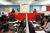 Auditors and tax consultants are seen working at the Ernst & Young Global Shared Services office in Bangalore, Karnataka, India. Ernst & Young has 49% women working for them in the India office. Photo: Sanjit Das